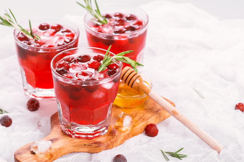 Cranberry cocktail with rosemary garnish,